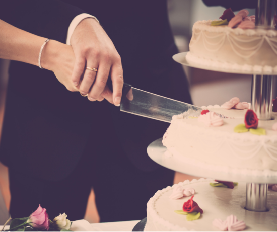 wedding cake being cut