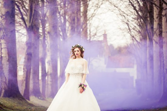 bride with purple smoke bomb background