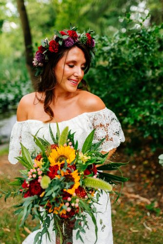 bride with sunflower wedding bouquet and wearing flower crown