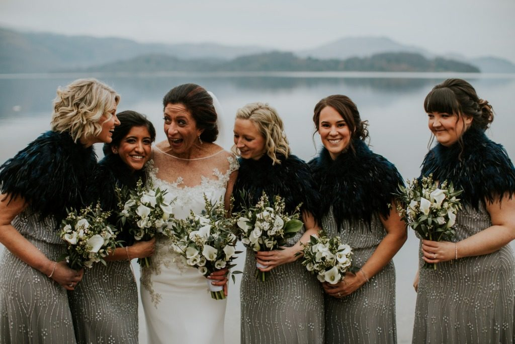 bride and bridesmaids with flowers