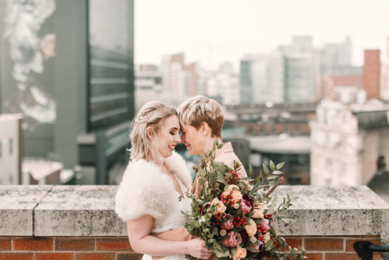 two brides with wedding bouquet