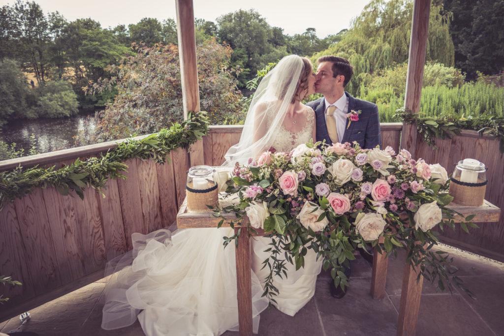 bride and groom kiss at wedding