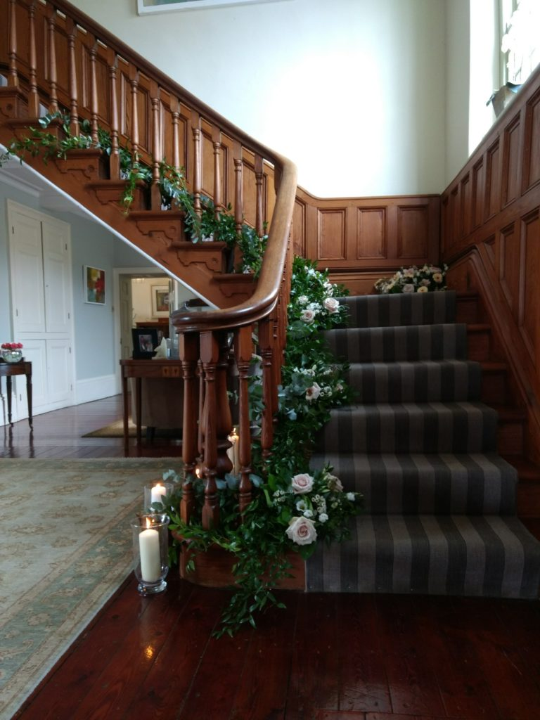 staircase with greenery and flowers