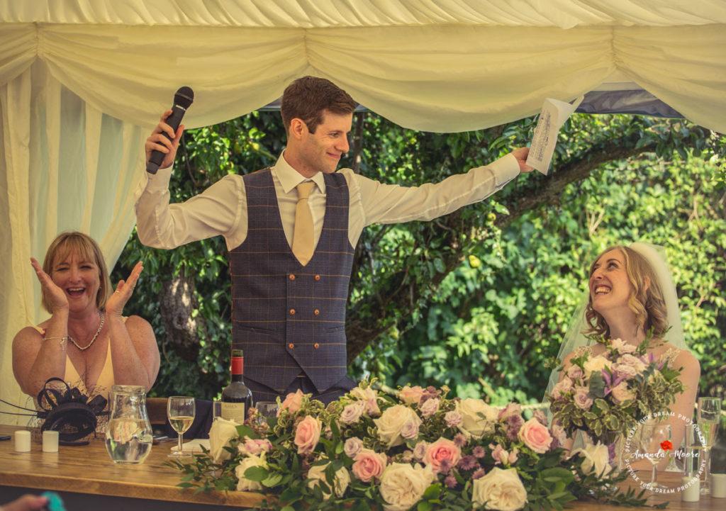 groom celebrating at wedding