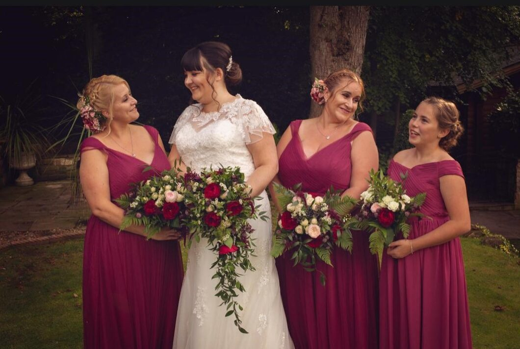 bride and bridesmaids holding bouquets